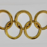 DominoJewellery.com - gilded Olympic Rings hand carved from albizia wood 2012