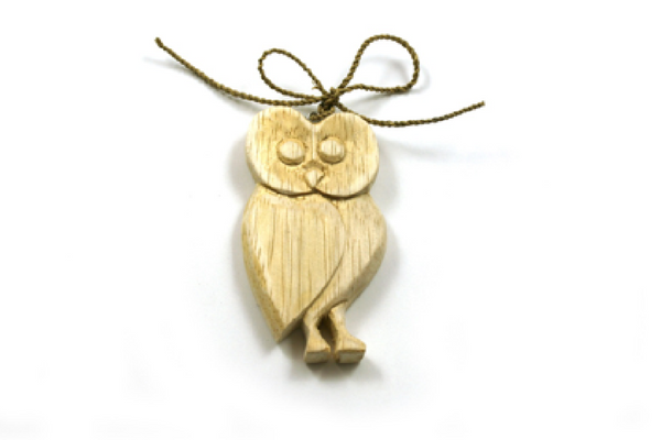 Hand carved wooden owl decoration on sisal string. Height 8cm