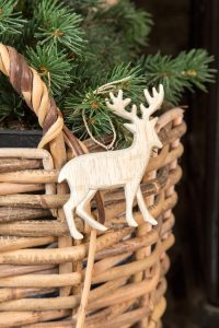 hand carved wooden stag and wicker log basket