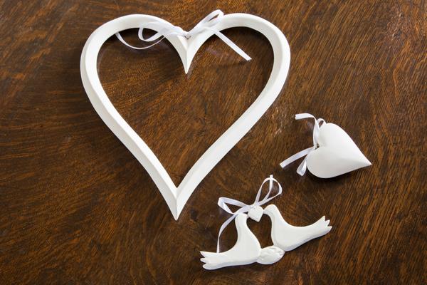 Wooden open heart on a ribbon