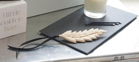 Emily has designed a #bespoke and #ethically sourced #wooden decoration #handmade from #sustainable #eco friendly wood in the shape of a feather for #AntheaTurner s new venture #The At Home Box Company .