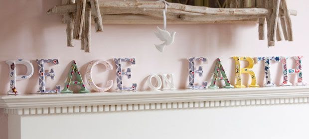 floral wooden letters PEACE on EARTH