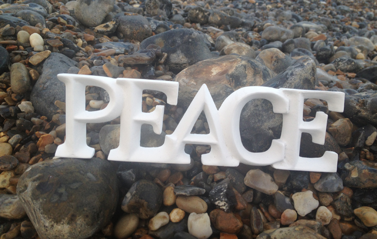 carved wooden peace